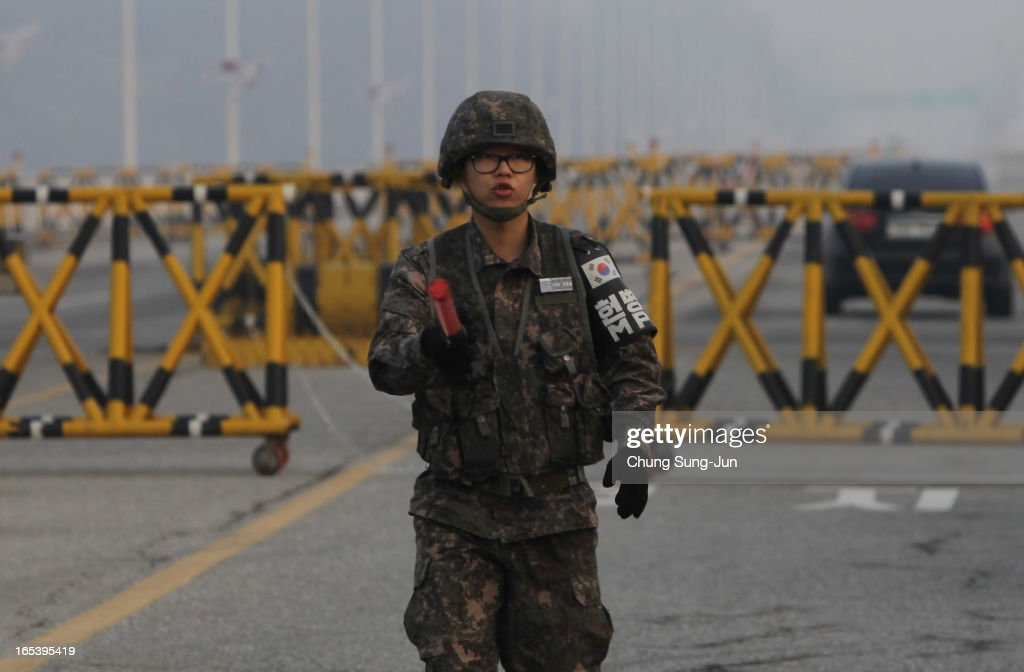 A South Korean soldier stands at the check point in Paju on April 4, 2013 in Paju, South Korea. 400 South Koreans remain in the joint industrial complex fearing they can not get back there once return to South. In recent weeks North Korea have threatened to attack South Korea and U.S. military bases.