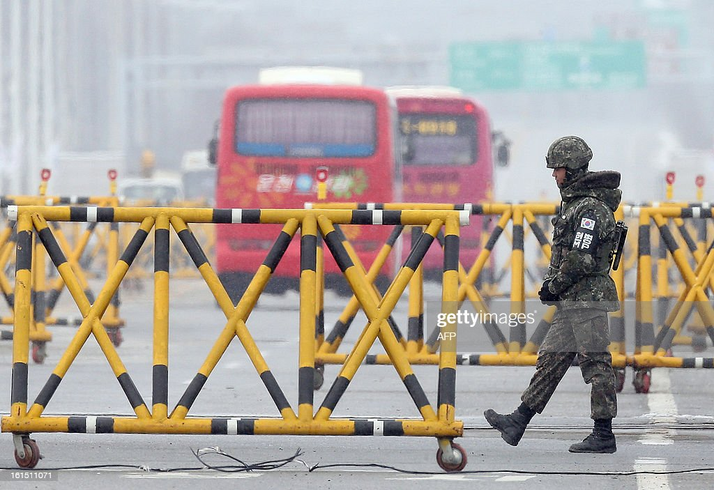 A South Korean soldier stands guard at a military check point in Paju near the demilitarized zone dividing the two Koreas on February 12, 2013. North Korea on February 12 staged its most powerful nuclear test yet, claiming a breakthrough with a 'miniaturised' device in a striking act of defiance that drew condemnation from global powers including its sole patron China. REPUBLIC