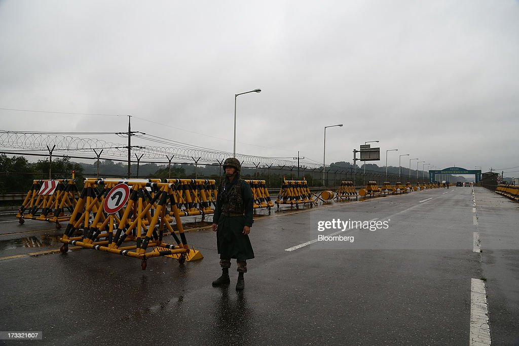 A South Korean soldier stands guard at a military check point on the Unification Bridge linked to North Korea near the demilitarized zone in Paju...