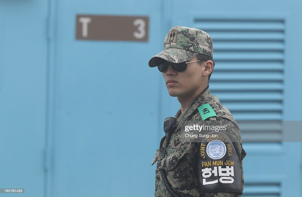 A South Korean soldier stands guard at the border village of Panmunjom between South and North Korea at the Demilitarized Zone (DMZ) on February 27, 2013 in South Korea. North Korea confirmed it had successfully carried out an underground nuclear test on February 12, as a shallow earthquake with a magnitude of 4.9 was detected by several international monitoring agencies.