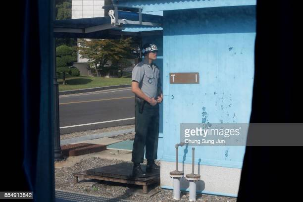 South Korean soldier stands guard at the border village of Panmunjom between South and North Korea at the Demilitarized Zone on September 28 2017 in...