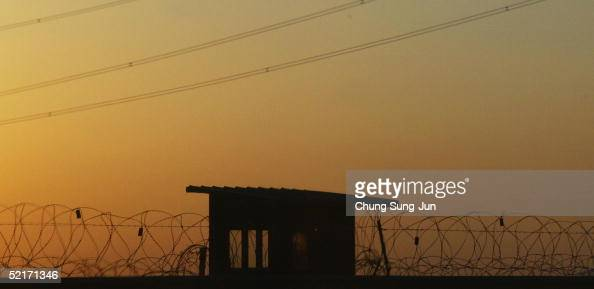 South Korean soldier stands guard in checkpoint as the sunsets near the border between South and North Korea on February 10 2005 in Paju north of...