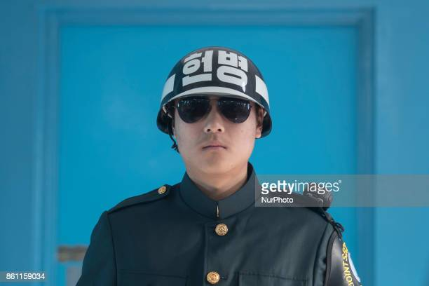 A South Korean soldier stands guard in front of a door that leads to North Korea inside the Joint Security Area conference room in the border village...