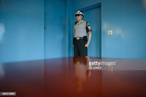 A South Korean soldier stands guard inside a military armistice committee meeting room at the truce village of Panmunjom in the Demilitarized Zone...