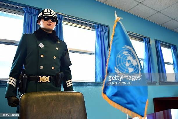 A South Korean soldier stands guard inside of a UN conference building at the truce village of Panmunjom in the Demilitarized Zone dividing the two...
