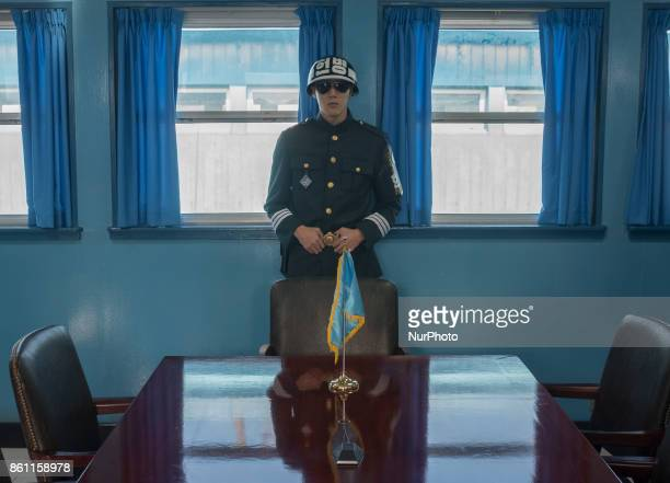A South Korean soldier stands guard inside the Joint Security Area conference room in the border village of Panmunjom between South and North Korea...