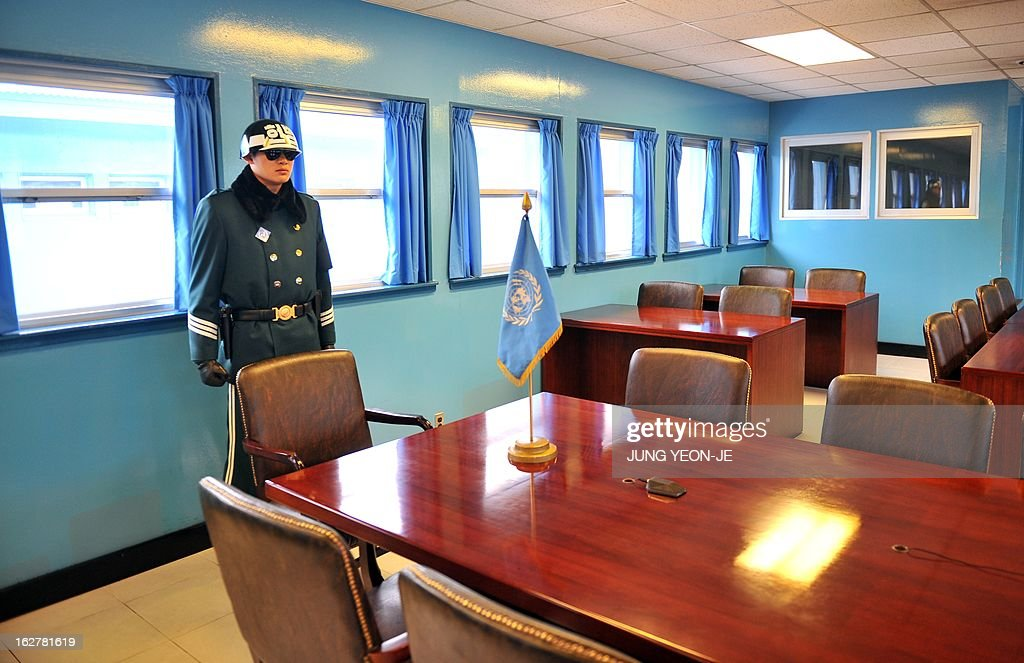 A South Korean soldier stands guard inside the UN conference room at the truce village of Panmunjom in the demilitarized zone dividing North and South Korea on February 27, 2013. North Korean leader Kim Jong-Un oversaw a live-fire artillery drill aimed at simulating an 'actual war', state media said on February 26, a day after South Korea swore in its first female president. AFP PHOTO / JUNG YEON-JE