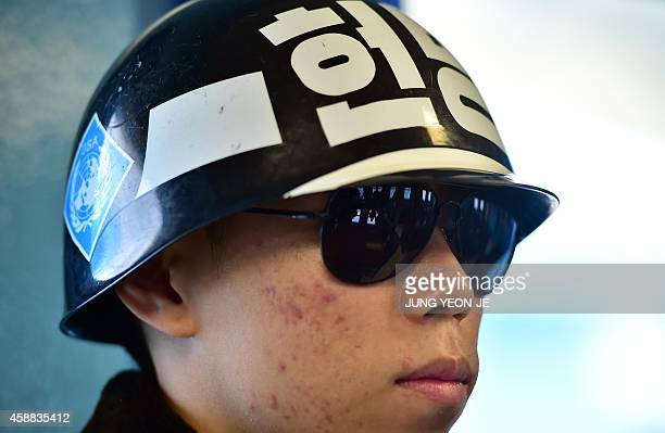A South Korean soldier stands guard inside the UN conference room at the truce village of Panmunjom in the Demilitarized Zone dividing the two Koreas...