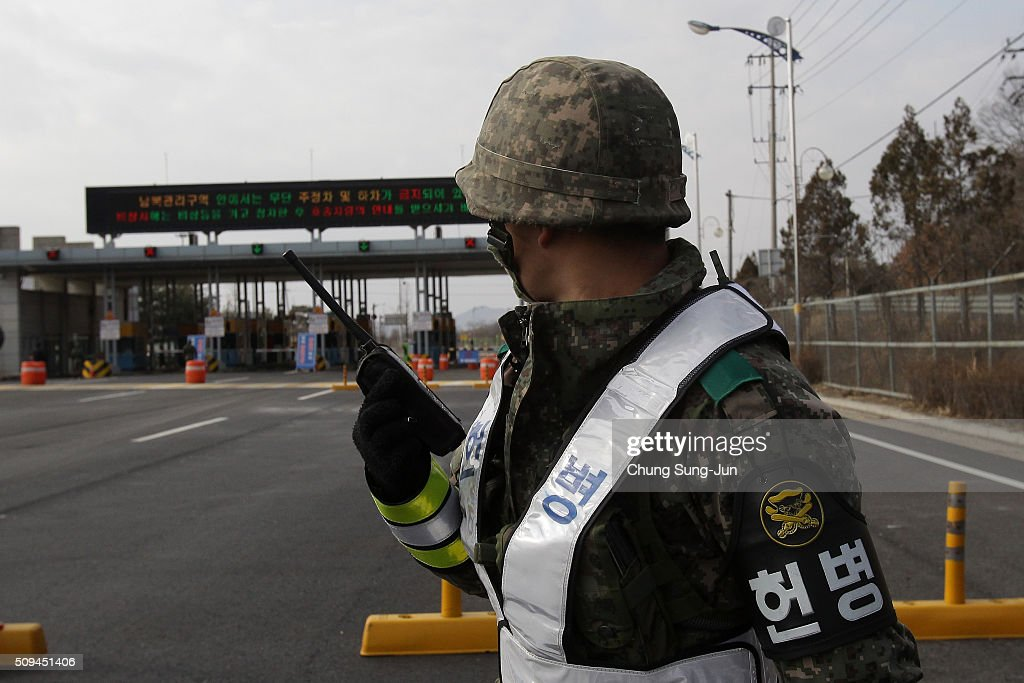 A South Korean soldier stands guard on patrol at the customs, immigration and quarantine (CIQ) office on February 11, 2016 in Paju, South Korea. South Korea announced on February 10, 2016 that the country would close an industrial complex jointly ran with North Korea, as the strongest response for North's recent nuclear test and rocket launch.