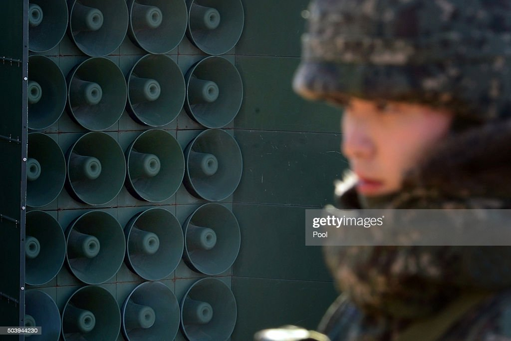 A South Korean soldier stands next to the loudspeakers near the border area between South Korea and North Korea on January 8 2016 in Yeoncheon South...