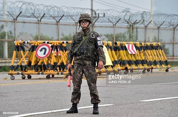 A South Korean soldier stands on the road leading to North Korea's Kaesong joint industrial complex at a military checkpoint in the border city of...