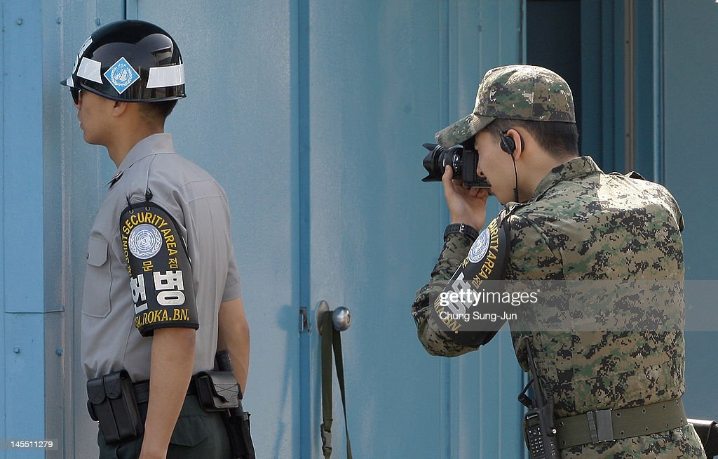 A South Korean soldier takes a photo as King Carl XVI Gustaf of Sweden and Queen Silvia of Sweden visit at the border village of panmunjom between South and North Korea in the demilitarized zone (DMZ) on June 1, 2012, South Korea. The Swedish royals are on the four-day tour to South Korea.