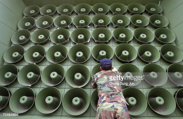South Korean soldier takes down a battery of propaganda loudspeakers on the border with North Korea in Paju on 16 June 2004 in Paju South Korea The...