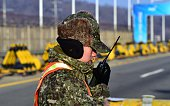 A South Korean soldier talks over a radio on the road leading to North Korea's Kaesong joint industrial complex at a military checkpoint in the...