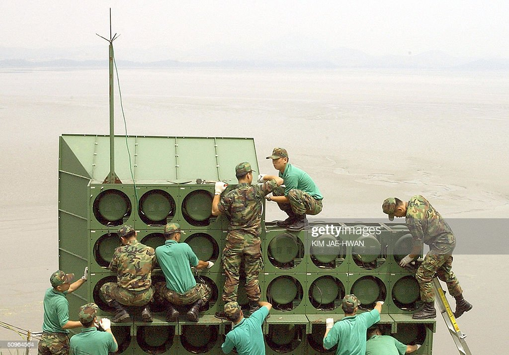 South Korean soldier tear down a battery of propaganda loudspeakers along the border with North Korea in Paju on 16 June 2004 The dismantlement...