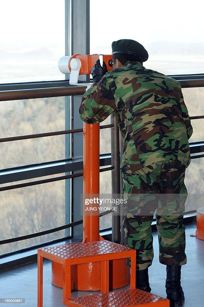 A South Korean soldier uses a viewer to look at the North side from a South Korean observation post in Paju near the Demilitarized Zone (DMZ) dividing the two Koreas on January 25, 2013. North Korea on January 25 threatened 'physical counter-measures' against rival South Korea, the latest in a series of bellicose warnings sparked by a tightening of UN sanctions against Pyongyang.