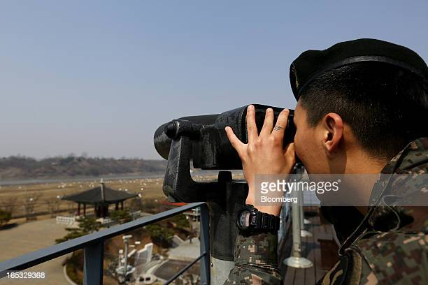 A South Korean soldier uses binoculars as he looks across to the north side of the border at the Imjingak pavilion near the demilitarized zone in...