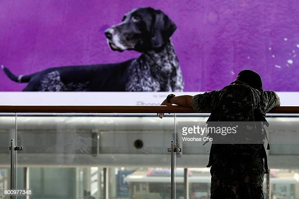 South Korean soldier waits train to return to his unit at the Seoul Railway Station on September 9 2016 in Seoul South Korea North Korea is suspected...