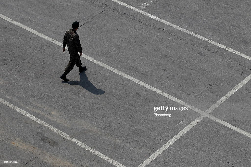 A South Korean soldier walks through the Imjingak pavilion near the demilitarized zone (DMZ) in Paju, South Korea, on Wednesday, April 3, 2013. North Korea prevented South Korean workers from entering a jointly run industrial park today, adding to tensions after saying it will restart a mothballed nuclear plant and threatening to attack its southern neighbor. Photographer: SeongJoon Cho/Bloomberg via Getty Images