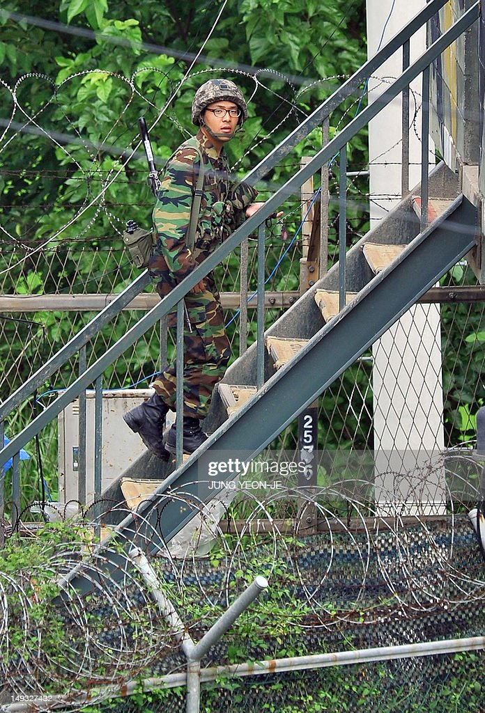 A South Korean soldier walks up the stairs of a guard post in a sideline of Imjingak peace park in Paju, near the demilitarized zone dividing the two Koreas on July 27, 2012, on the day of the 59th anniversary of signing the Korean War armistice. The armistice agreement on July 27, 1953 brought three years of active combat in the Korean War to a halt, but the two Koreas are still technically at war as no formal peace treaty was signed.