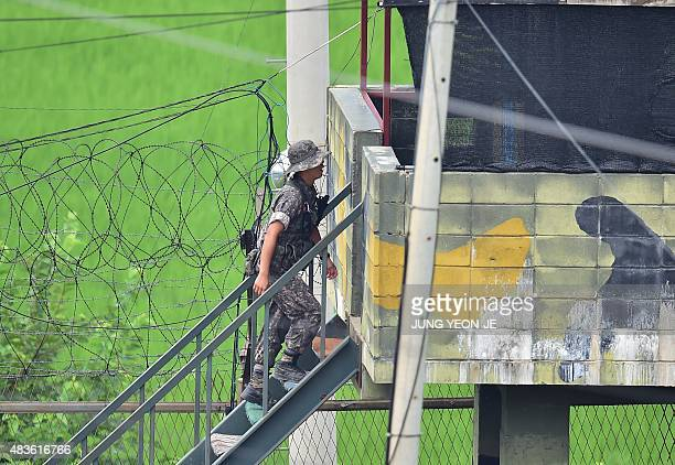 A South Korean soldier walks up the stairs of a guard post in a sideline of Imjingak peace park near the demilitarized zone dividing the two Koreas...