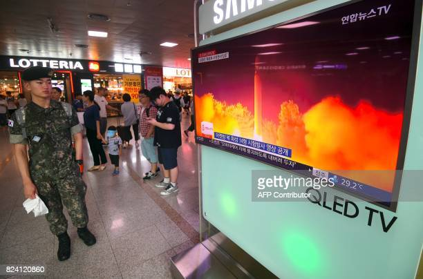A South Korean soldier watches a television screen showing a video footage of North Korea's latest test launch of an intercontinental ballistic...
