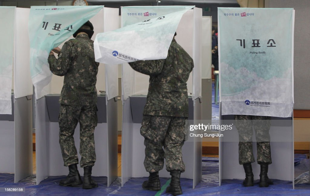 South Korean soldiers cast their absentee ballots for new President in a polling station on December 13, 2012 in Seoul, South Korea. South Koreans vote in the presidential election on December 19.