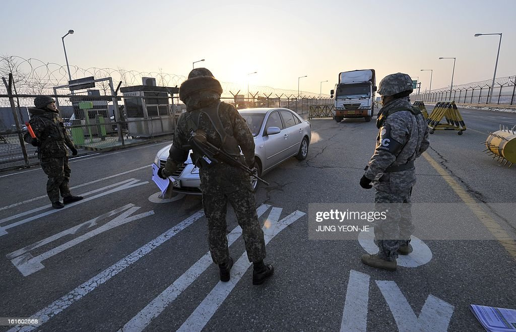 South Korean soldiers check vehicles on a road linking North Korea's Kaesong Industrial Complex at a military check point in Paju near the demilitarized zone dividing the two Koreas on February 13, 2013. North Korea on February 12 staged its most powerful nuclear test yet and warned of 'stronger' action to follow if the ensuing wave of global condemnation translated into tougher sanctions.