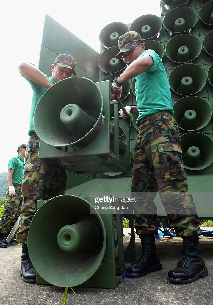 South Korean soldiers disassmeble a battery of propaganda loudspeakers on the border with North Korea on 16 June 2004 in Paju South Korea The removal...