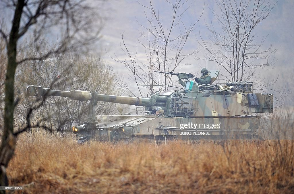 South Korean soldiers drives a K-55 self-propelled howitzer at a military training field on the border city of Paju on April 2, 2013. South Korea's new president on April 1 promised a strong military response to any North Korean provocation after Pyongyang announced that the two countries were now in a state of war.