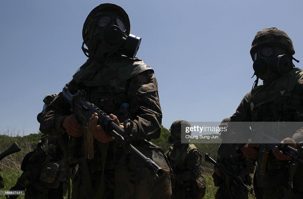 South Korean soldiers from 9th infantry division participate in decontamination training a part of Steel Zenith Field training exercise on May 16...