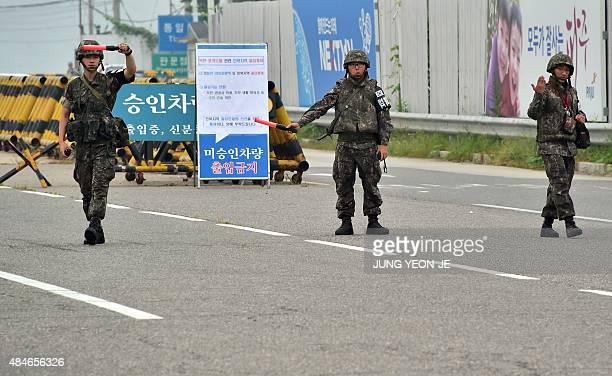 South Korean soldiers gesture to vehicles on the road leading to North Korea's Kaesong joint industrial complex at a military checkpoint in the...