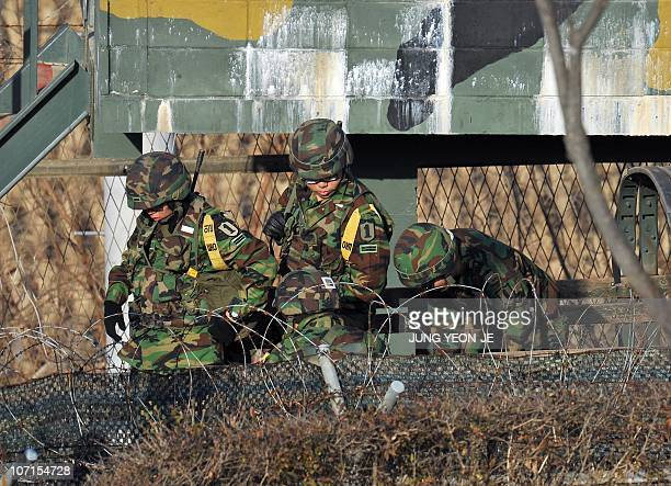 South Korean soldiers get out of a military truck at a military guard area in Paju near the Demilitarized Zone separating North and South Korea on...