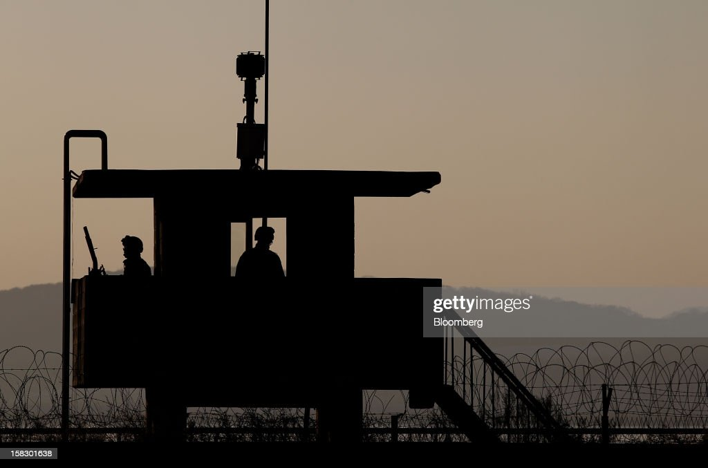 South Korean soldiers guard a post near the demilitarized zone (DMZ) in Paju, South Korea, on Wednesday, Dec. 12, 2012. North Korea fired a rocket that placed a satellite into orbit, defying international sanctions and showcasing the nuclear-armed totalitarian regime's progress in ballistic missile technology. Photographer: SeongJoon Cho/Bloomberg via Getty Images