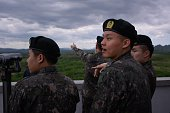 South Korean soldiers look out towards the demilitarized zone and North Korea at the Cheorwon Peace Observatory on May 20 2015 Photos taken from the...