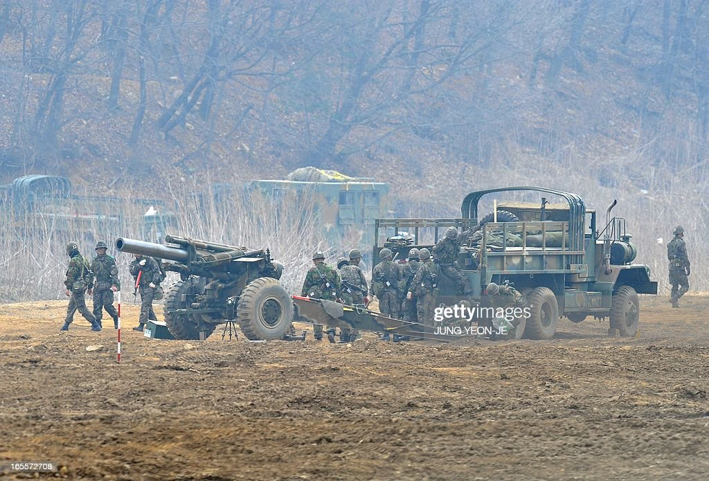 South Korean soldiers man a cannon at a military training field in the border city of Paju on April 5, 2013. The United States said it was taking 'all necessary precautions' after North Korea rang fresh alarms in an escalating crisis by moving a medium-range missile to its east coast.