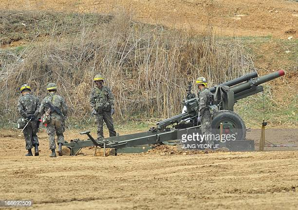 South Korean soldiers man a cannon at a military training field in the border city of Paju on April 16 2013 North Korea's military on April 16...