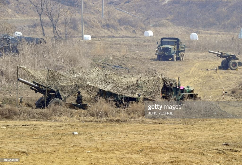 South Korean soldiers man cannons at a military training field in the border city of Paju on April 4, 2013. North Korea dramatically escalated its warlike rhetoric on April 4, warning that it had authorised plans for nuclear strikes on targets in the United States.
