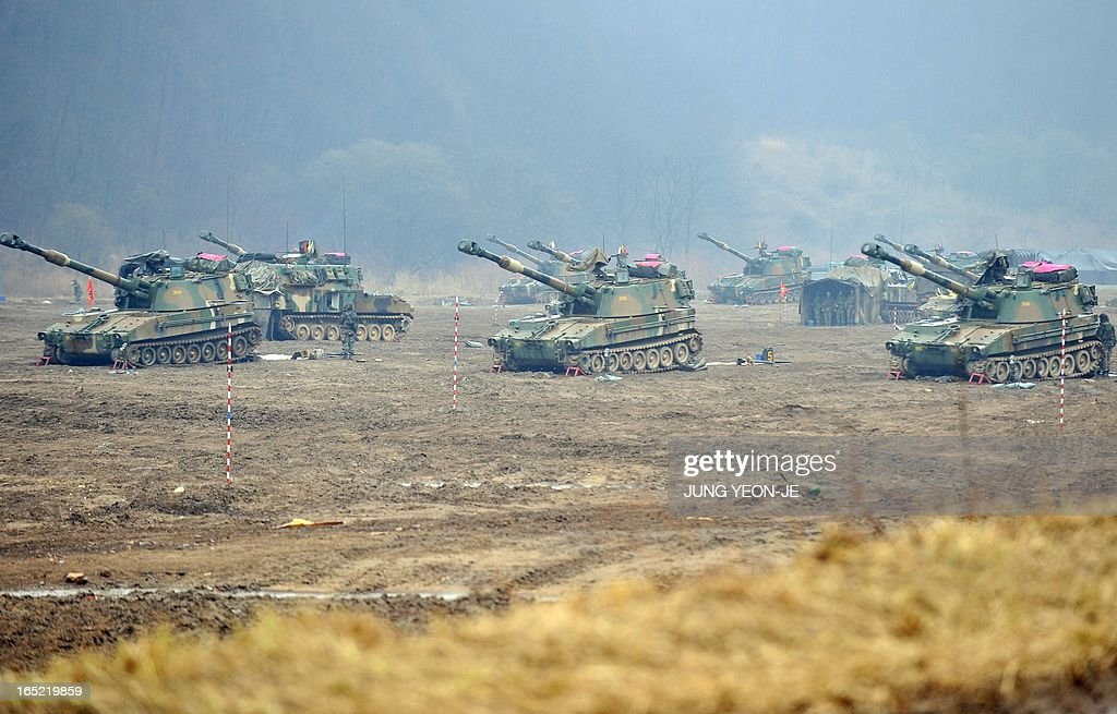 South Korean soldiers man K-55 self-propelled howitzers at a military training field on the border city of Paju on April 2, 2013. South Korea's new president on April 1 promised a strong military response to any North Korean provocation after Pyongyang announced that the two countries were now in a state of war.