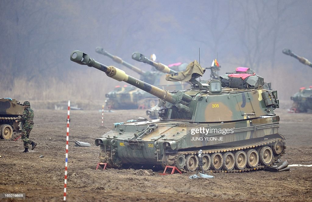 South Korean soldiers man K-55 self-propelled howitzers at a military training field on the border city of Paju on April 2, 2013. South Korea's new president on April 1 promised a strong military response to any North Korean provocation after Pyongyang announced that the two countries were now in a state of war. AFP PHOTO / JUNG YEON-JE
