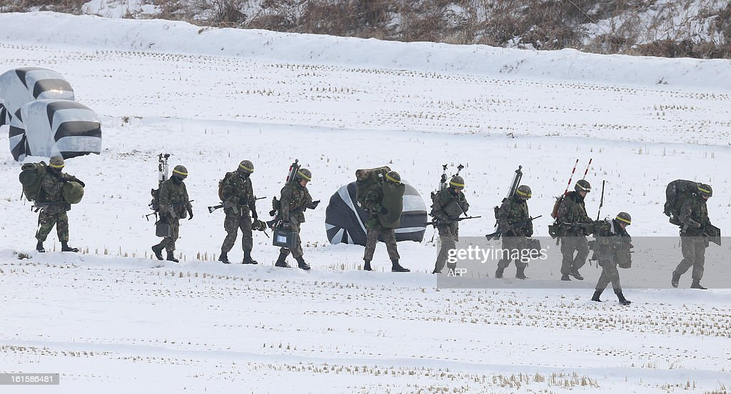 South Korean soldiers march during a military field exercise in Paju near the demilitarized zone dividing the two Koreas on February 12, 2013. North Korea on February 12 staged its most powerful nuclear test yet, claiming a breakthrough with a 'miniaturised' device in a striking act of defiance that drew condemnation from global powers including its sole patron China. REPUBLIC OF KOREA OUT AFP PHOTO/DONG-A ILBO