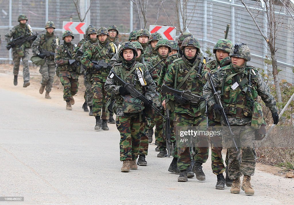 South Korean soldiers march during an exercise to mark the second anniversary of the North's shelling at Yeonpyeong island on November 23, 2012. South Korea marked on November 23, 2012 the anniversary of North Korea's 2010 shelling of a border island with a military drill and memorials, clouded by the threat of a fresh attack from Pyongyang. REPUBLIC OF KOREA OUT AFP PHOTO / DONG-A ILBO