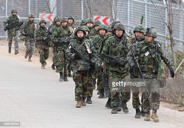 South Korean soldiers march during an exercise to mark the second anniversary of the North's shelling at Yeonpyeong island on November 23 2012 South...