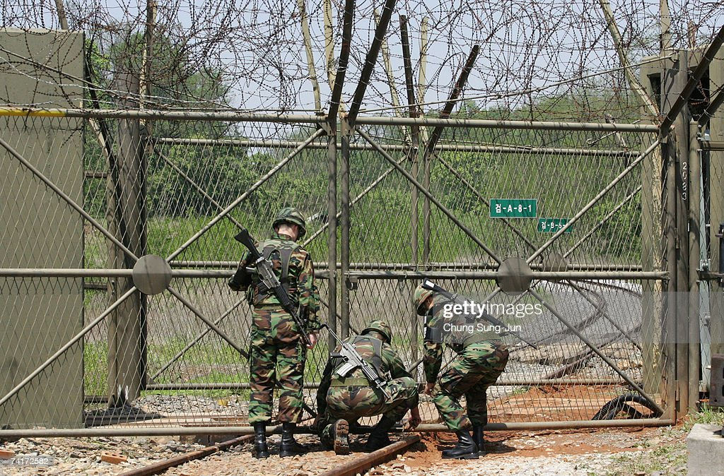 South Korean soldiers open the gate for the Demilitarized Zone before a train moved toward the Demilitarized Zone on the way to North Korea on May 17...