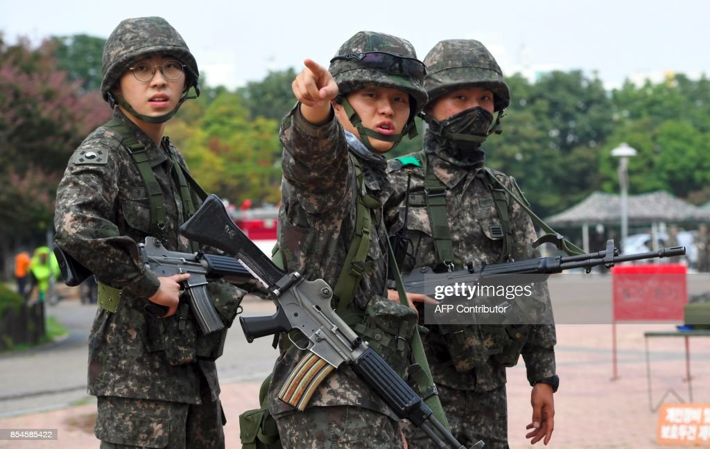 South Korean soldiers participate in a decontamination training at a stadium in Seoul on September 27, 2017. The training is designed to train their systems and capabilities to increase their preparedness to respond to chemical, biological and nuclear threats. Yeon-Je