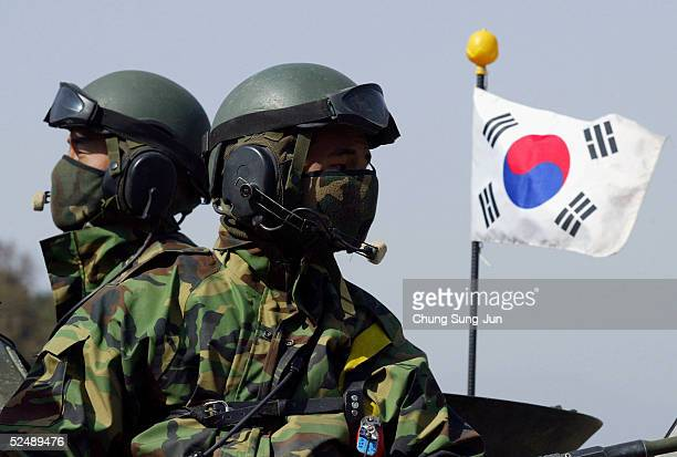 South Korean soldiers participate in a river crossing operation in preparation for possible North Korean attack on March 29 2005 in Yoju South Korea...