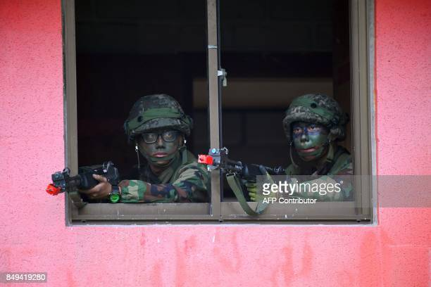 TOPSHOT South Korean soldiers participate in a South KoreaUS combined arms collective training exercise at the US army's Rodriguez shooting range in...