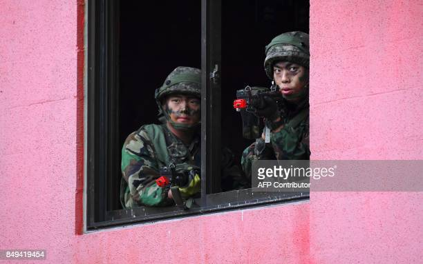 South Korean soldiers participate in a South KoreaUS combined arms collective training exercise at the US army's Rodriguez shooting range in Pocheon...
