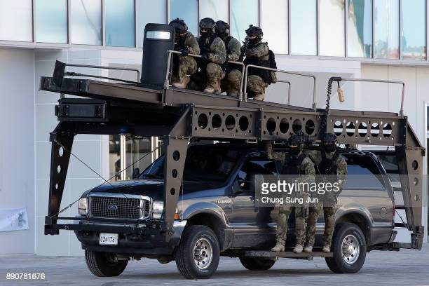South Korean soldiers participate in an antiterror drill at the Olympic Staduim venue of the Opening and Closing ceremony on December 12 2017 in...