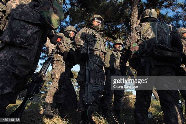 South Korean soldiers participate in the US and South Korean Marines joint landing operation at Pohang seashore on November 18 2014 in Pohang South...